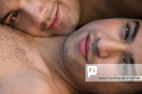 Portrait of a gay couple smiling