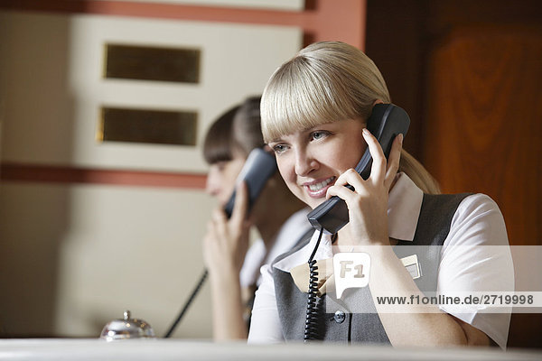 Hotel Receptionists on Telephone