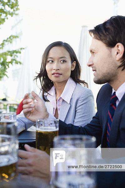 Germany  Bavaria  Upper Bavaria  Business people in beer garden
