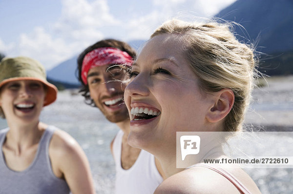 Germany  Tölzer Land  young people at lake  woman laughing