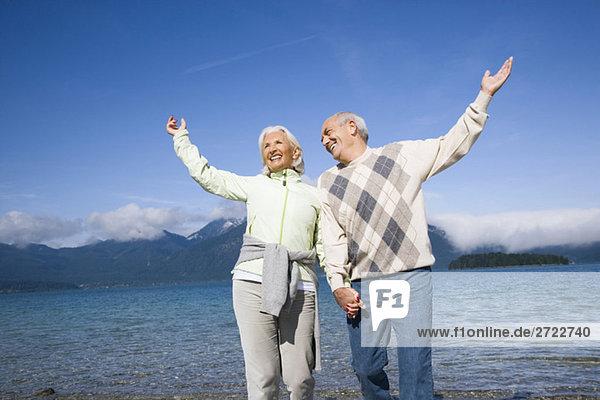 Germany  Bavaria  Walchensee  Senior couple cheering