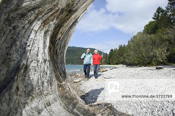 Germany  Bavaria  Walchensee  Senior couple hiking on lakeshore