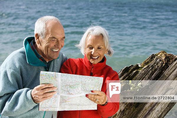 Germany  Bavaria  Walchensee  Senior couple looking at map