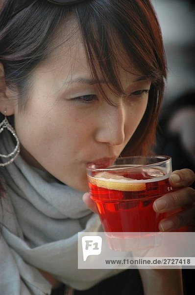 Venice Italy  a lady playing with her a Korean-American tourist drinking spritz