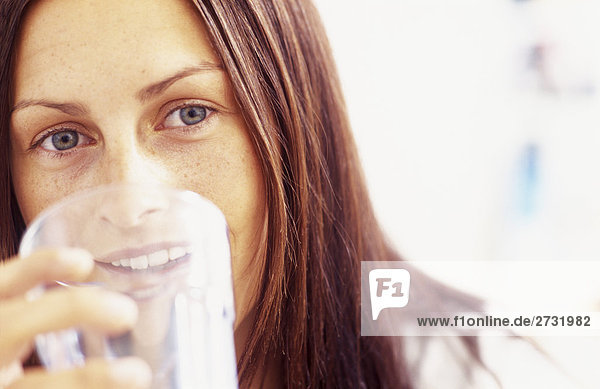 Young woman holding glass  portrait