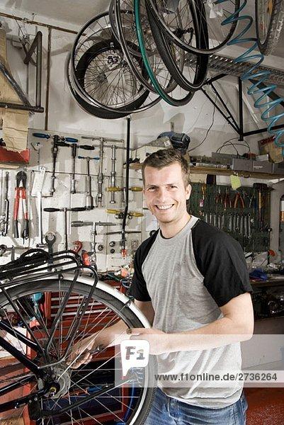 A man repairing a bike in a workshop