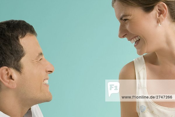 Close-up of a mid adult couple smiling
