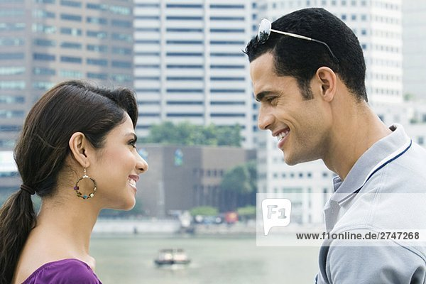Close-up of a couple looking at each other and smiling