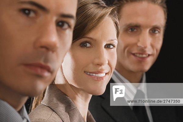 Portrait von drei Führungskräften