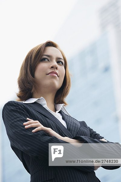 Close-up of a businesswoman thinking