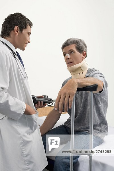 Male doctor talking to a patient in a hospital