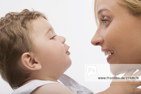Close-up of a mid adult woman looking at her son and smiling