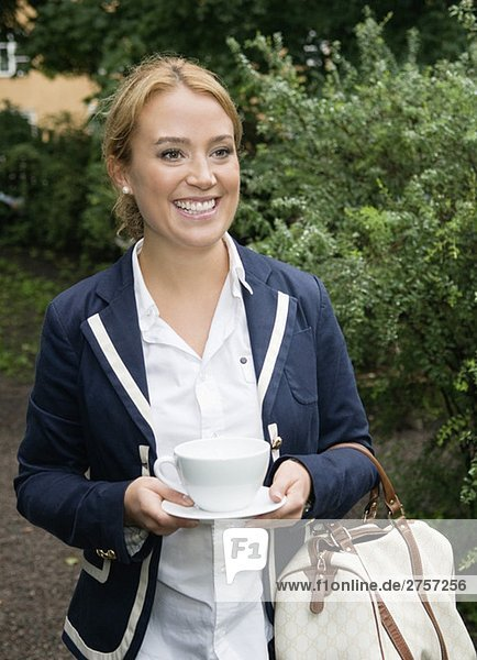 Young woman with coffie