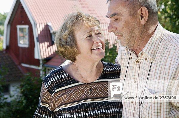 Elderly couple by house Elderly couple by house