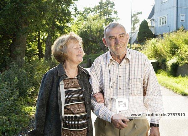 Eldery couple strolling Eldery couple strolling