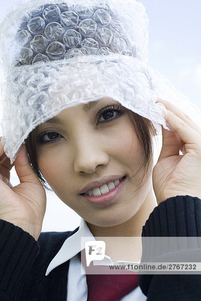 Young female wearing hat made of bubble wrap  portrait