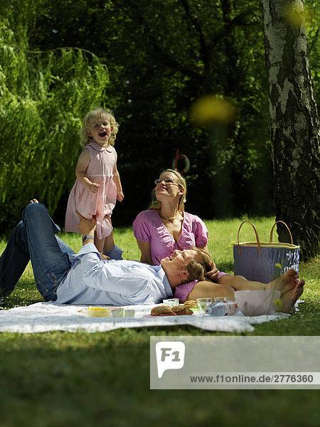 Family enjoying at picnic