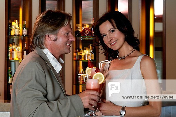 Couple is having cocktails in a bar