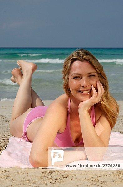 Woman lying on the beach