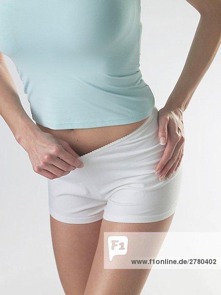 Frau mit weissen Shorts Frau mit weissen Shorts
