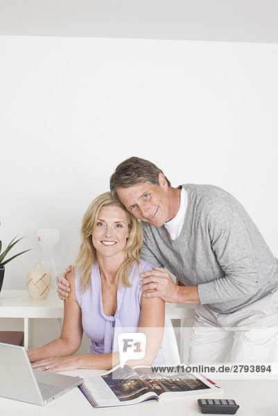 Portrait of couple in home office
