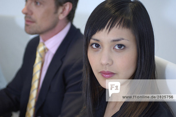 portrait of serious looking asian executive during meeting