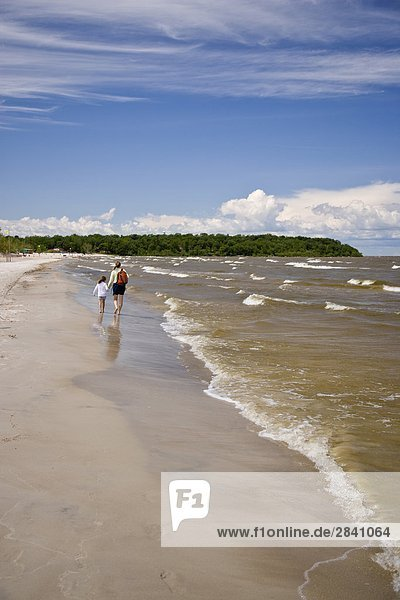 Mother and daughter enjoy day at Grand Beach Provincial Park  Manitoba  Canada.