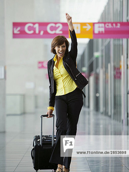 Businesswoman celebrating in airport 20138