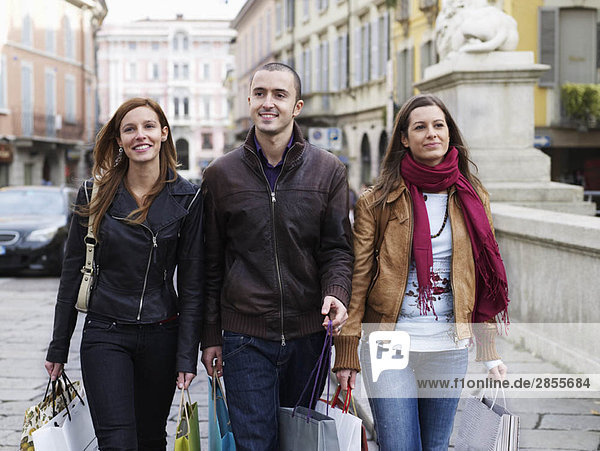 Young adults walking with shopping bags