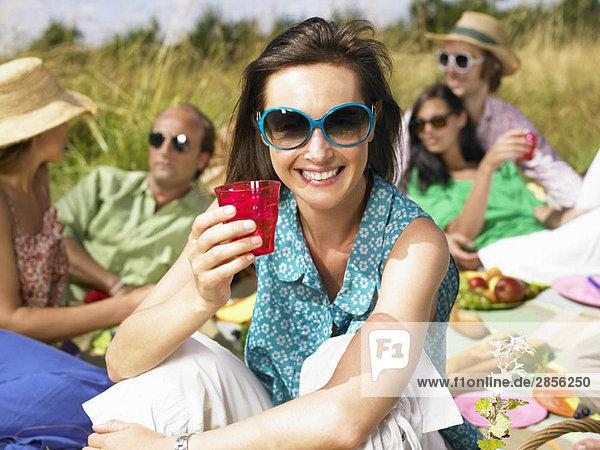 Friends having a picnic in a field