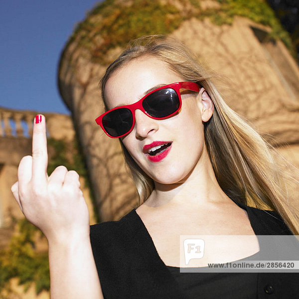 Blond woman giving the finger