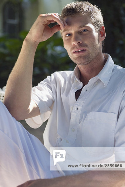Young man  hand on head  portrait