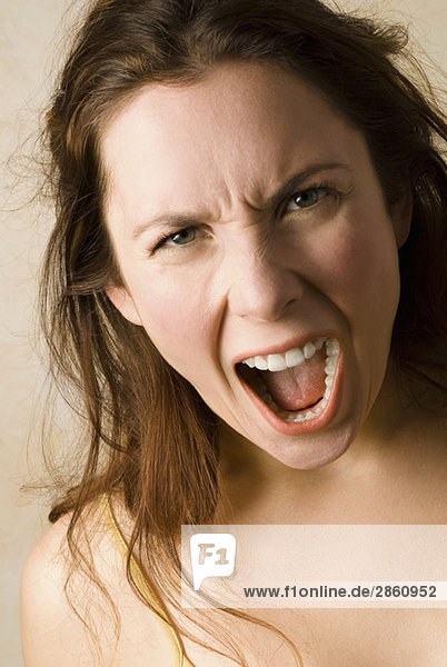Young woman  Boiling with rage  close up