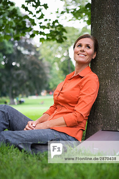 A woman resting in a park Sweden.