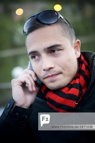 A man talking in his mobile phone Sweden.