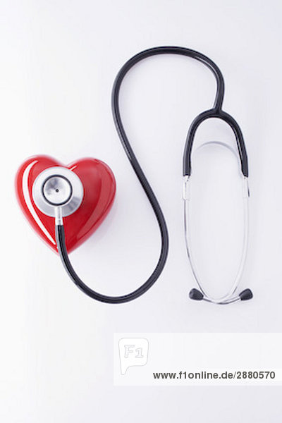still life of stethoscope and red heart