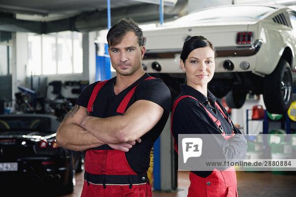 portrait of two mechanics in garage