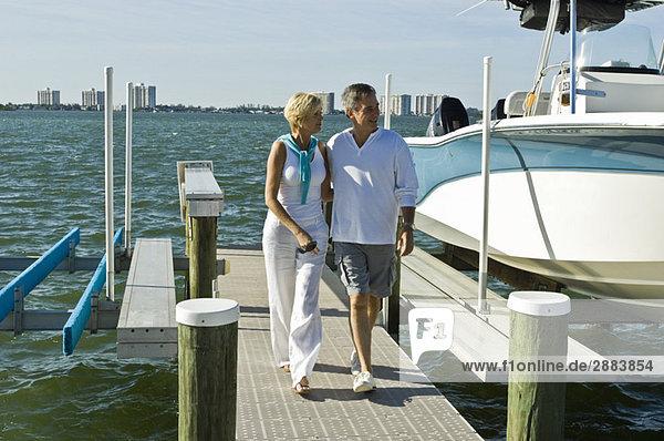 Couple walking on a pier