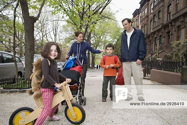 A family on a sidewalk  Brooklyn  New York City