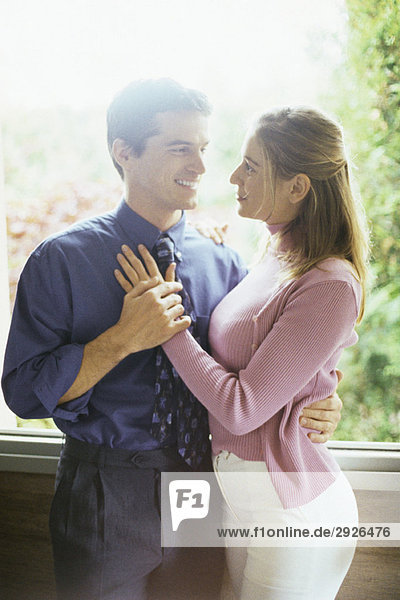 Couple embracing  gazing into each other's eyes  portrait