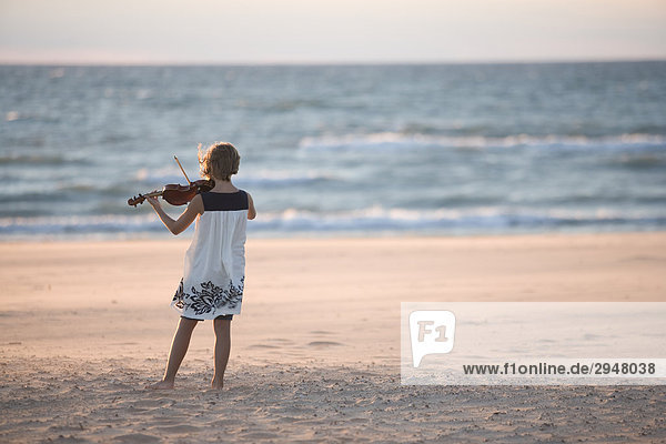 Girl playing the violin on a beach  Warrens Dunes State Park  Michigan