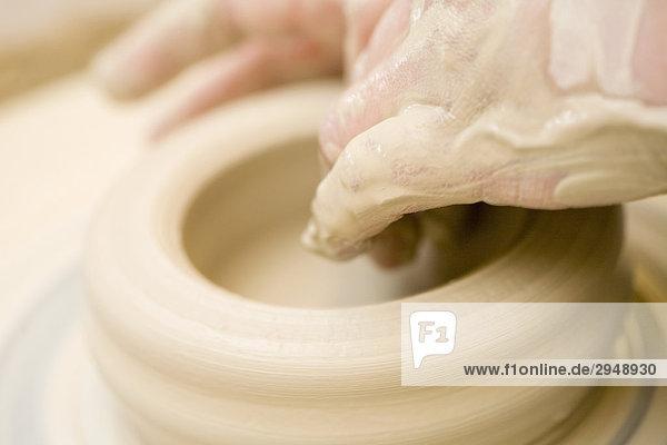Model creating a shape with a ceramics wheel  Spokane  Washington