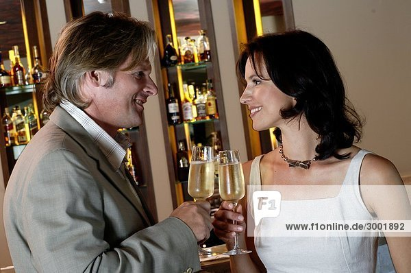 Couple is drinking champagne in a bar