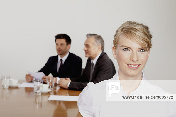 Three businesspeople in conference room, Bavaria, Germany d4kb3-145