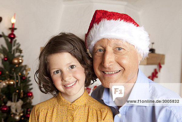 Girl and grandfather with Santa hat d4kb7-192