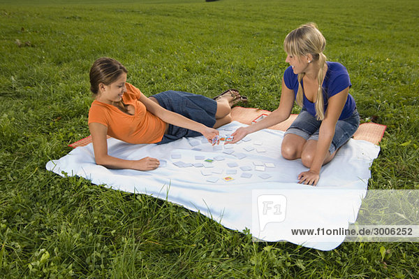 Two teenage girls playing memory game