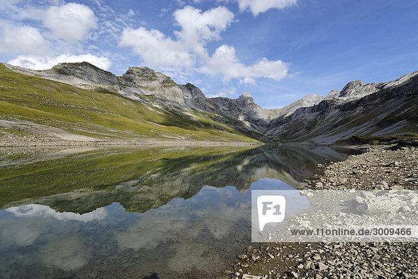 Glattalpe Glattalpsee in front of the Hoechturm and the Ortstock Bisistal near Muotatal Valley of Muota Canton of Schwyz Switzerland