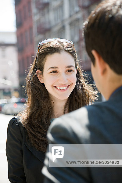 Young woman smiling at a man