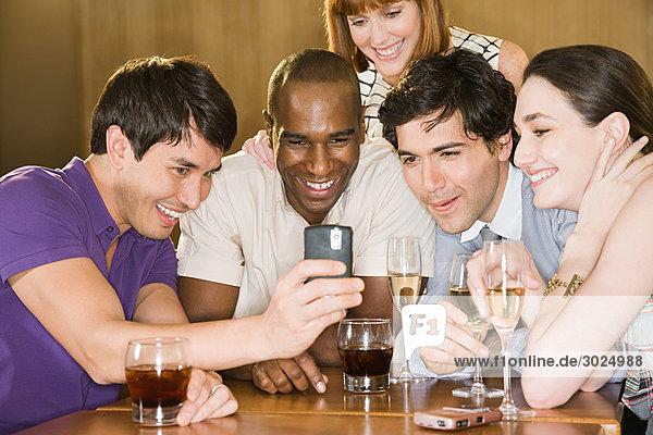 Five friends in a bar