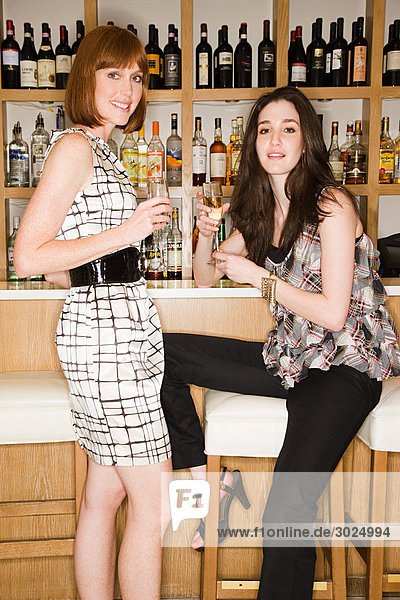 Two young women in a wine bar